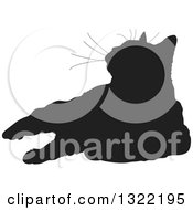 Clipart Of A Black Resting Cat Silhouette Looking Up Royalty Free Vector Illustration
