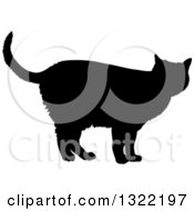 Clipart Of A Black Standing Cat Silhouette 3 Royalty Free Vector Illustration
