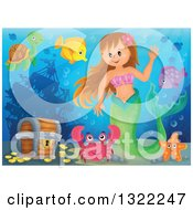 Clipart Of A Happy Caucasian Female Mermaid Waving By A Treasure Chest Surrounded By Sea Creatures Royalty Free Vector Illustration