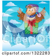 Clipart Of A Cartoon Festive Christmas Owl Flying With A Gift Over Snowy Mountains And Forest On A Winter Day Royalty Free Vector Illustration