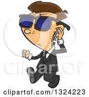 Clipart Of A Cartoon White Security Boy Walking And Adjusting An Ear Piece Royalty Free Vector Illustration