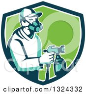 Clipart Of A Retro Male Painter Using A Spray Gun In A Blue White And Green Shield Royalty Free Vector Illustration