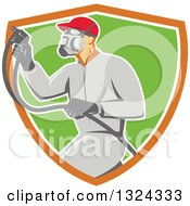Clipart Of A Retro Male Painter Using A Spray Gun And Emerging From An Orange White And Green Shield Royalty Free Vector Illustration