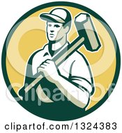 Clipart Of A Retro Male Construction Worker Carrying A Sledgehammer In A Green And Yellow Circle Royalty Free Vector Illustration
