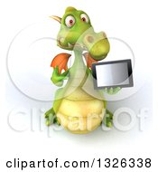 Clipart Of A 3d Green Dragon Holding Up And Pointing To A Tablet Computer Royalty Free Illustration