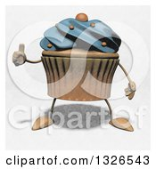 Clipart Of A Sketched Blue Frosted Cupcake Character Giving A Thumb Up Royalty Free Illustration by Julos