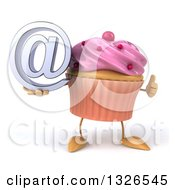 Clipart Of A 3d Pink Frosted Cupcake Character Holding An Email Arobase At Symbol And Giving A Thumb Up Royalty Free Illustration by Julos