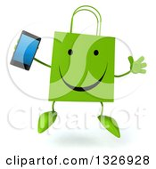 Clipart Of A 3d Happy Green Shopping Or Gift Bag Character Jumping And Holding A Smart Phone Royalty Free Illustration