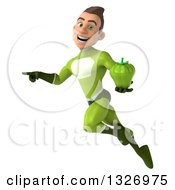 Clipart Of A 3d Young White Male Super Hero In A Green Suit Flying Pointing And Holding A Green Bell Pepper Royalty Free Illustration