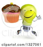 Clipart Of A 3d Happy Yellow Light Bulb Character Jumping And Holding A Chocolate Frosted Cupcake Royalty Free Illustration