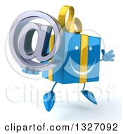 Clipart Of A 3d Happy Blue Gift Character Facing Slightly Right Jumping And Holding An Email Arobase At Symbol Royalty Free Illustration by Julos