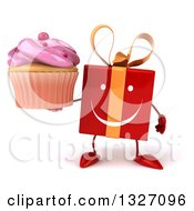 Clipart Of A 3d Happy Red Gift Character Holding A Pink Frosted Cupcake Royalty Free Illustration by Julos