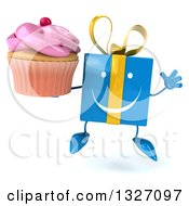 Clipart Of A 3d Happy Blue Gift Character Jumping And Holding A Pink Frosted Cupcake Royalty Free Illustration by Julos