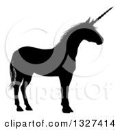 Clipart Of A Black Silhouetted Unicorn In Profile Facing Right Royalty Free Vector Illustration by AtStockIllustration