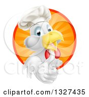 Clipart Of A Happy White Chef Chicken Giving A Thumb Up And Emerging From A Circle Of Sun Rays Royalty Free Vector Illustration