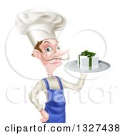 Clipart Of A White Male Chef With A Curling Mustache Holding A Gift On A Platter Royalty Free Vector Illustration