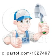 Clipart Of A Young Brunette White Male Gardener In Blue Holding Up A Shovel And Giving A Thumb Up Royalty Free Vector Illustration