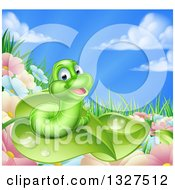Clipart Of A Cartoon Happy Green Worm On A Leaf Over Flowers In A Meadow Royalty Free Vector Illustration by AtStockIllustration