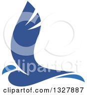 Clipart Of A Two Toned Flying Blue Bird Royalty Free Vector Illustration
