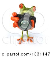 Clipart Of A 3d Green Springer Frog Looking Up Taking Pictures With A Camera Royalty Free Illustration
