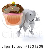 Clipart Of A 3d Happy Tooth Character Facing Slightly Right Jumping And Holding A Chocolate Frosted Cupcake Royalty Free Illustration