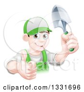 Clipart Of A Young Brunette White Male Gardener In Green Holding Up A Shovel And Giving A Thumb Up Royalty Free Vector Illustration
