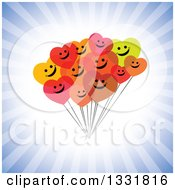 Clipart Of A Cluster Of Hapy Heart Balloons Smiling Over A Burst Of Blue Rays Royalty Free Vector Illustration