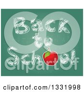 Red Apple And Sketched Back To School Text On A Chalkboard
