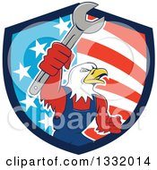 Clipart Of A Cartoon Bald Eagle Mechanic Man Holding Up A Wrench In An American Shield Royalty Free Vector Illustration