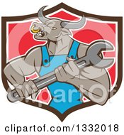 Clipart Of A Cartoon Angry Tan Bull Man Mechanic Holding A Wrench In A Black White And Red Shield Royalty Free Vector Illustration by patrimonio