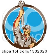 Clipart Of A Retro Male Mechanic Holding A Wrench Above His Head In A Brown White And Blue Circle Royalty Free Vector Illustration