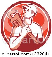 Clipart Of A Retro Male Plumber Holding A Monkey Wrench In A Red And White Circle Royalty Free Vector Illustration