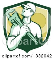 Clipart Of A Retro Male Plumber Holding A Monkey Wrench In A Green And White Shield Royalty Free Vector Illustration