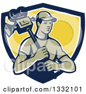 Clipart Of A Retro Male Cameraman In A Navy Blue White And Yellow Shield Royalty Free Vector Illustration