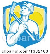 Clipart Of A Retro Male Coal Miner Holding A Pickaxe In A Blue White And Yellow Shield Royalty Free Vector Illustration