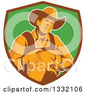 Clipart Of A Retro Male Farmer Holding A Piglet In A Brown And Green Shield Royalty Free Vector Illustration