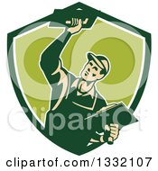 Clipart Of A Retro Male Plasterer Working With Trowels In A Green And White Shield Royalty Free Vector Illustration