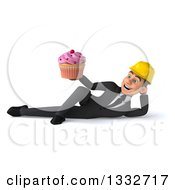 Clipart Of A 3d Young White Male Architect Resting On His Side And Holding A Pink Frosted Cupcake Royalty Free Illustration