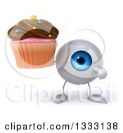 Clipart Of A 3d Blue Eyeball Character Holding And Pointing To A Chocolate Frosted Cupcake Royalty Free Illustration