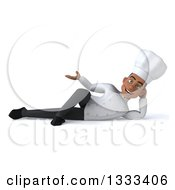 Clipart Of A 3d Young Black Male Chef Resting On His Side And Presenting Royalty Free Illustration