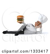 Clipart Of A 3d Young Black Male Chef Resting On His Side And Holding A Double Cheeseburger Royalty Free Illustration