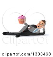Clipart Of A 3d Happy Young White Super Businessman Resting On His Side And Holding A Cupcake Royalty Free Illustration