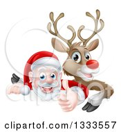 Clipart Of A Cartoon Christmas Red Nosed Reindeer And Santa Giving A Thumb Up Over A Sign Royalty Free Vector Illustration