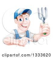 Clipart Of A Middle Aged Brunette White Male Gardener In Blue Holding Up A Garden Fork And Pointing Royalty Free Vector Illustration