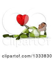 Clipart Of A 3d Young Black Male Super Hero In A Green Suit Resting On His Side And Holding A Heart Royalty Free Illustration