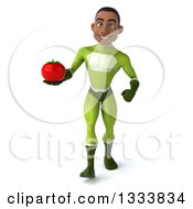 Clipart Of A 3d Young Black Male Super Hero In A Green Suit Walking And Holding A Tomato Royalty Free Illustration