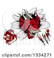 Clipart Of A Fierce Red Dragon Mascot Slashing Through A Wall Royalty Free Vector Illustration