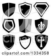 Clipart Of Grayscale Shield Designs One With A Templar Cross And One With A Fleur De Lis Royalty Free Vector Illustration by michaeltravers