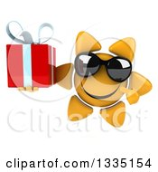 Clipart Of A 3d Happy Sun Character Wearing Shades Holding And Pointing To A Gift Royalty Free Illustration