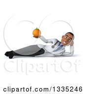 Clipart Of A 3d Young Black Male Nutritionist Doctor Resting On His Side And And Holding A Navel Orange Royalty Free Illustration